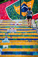 A girl climbs the Selaron's Stairs (Escadaria Selarón), a mosaic staircase made of colorful tiles, in Rio de Janeiro, Brazil, 12 February 2012. World-famous staircase, mostly covered by vibrant yellow, green and blue tiles (inspired by the colors of the Brazilian flag), is the masterpiece of Chilean-born artist Jorge Selarón who considers it as a personal tribute to the Brazilian people. Connecting the neighborhoods of Santa Teresa and Lapa, the stairway is made up of 250 steps and measures 125 meters long. In 1990 Selarón began work on the stairway, creating a constantly evolving piece of art, now adorned with over 2,000 brightly colored tiles collected from over 60 countries. Selarón funds his one man's project through donations and the sale of his black-and-red paintings which mostly depict a pregnant African woman or himself. Living his passion, the eccentric 65-year-old artist claims that this crazy and unique dream will only end on the day of my death.