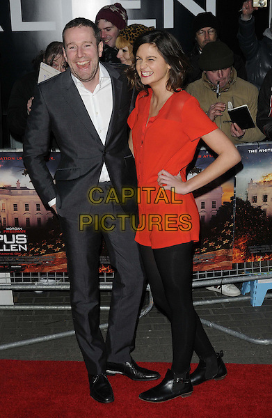 Max Rushden & guest.The UK premiere of 'Olympus Has Fallen', BFI Imax, London, England..3rd April 2013.full length black red dress tights hand on hip suit jacket hand in pocket.CAP/CAN.©Can Nguyen/Capital Pictures.