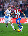 Filipe Luis (r) of Club Atletico de Madrid fights for the ball with Ignacio Camacho Barnola of Malaga CF during their La Liga match between Club Atletico de Madrid and Malaga CF at the Estadio Vicente Calderón on 29 October 2016 in Madrid, Spain. Photo by Diego Gonzalez Souto / Power Sport Images