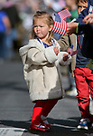 Gemma Carter, 2, of Carson City, watches the annual Veterans Day parade in Virginia City, Nev., on Monday, Nov. 11, 2013.<br /> Photo by Cathleen Allison