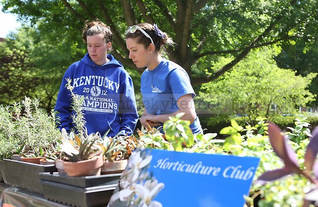 Natural resource and environmental science junior Anna Mucy, left, and Horticulture sophomore Alexis Amorese sell plants at Agriculture Awareness Day near Memorial Hall on 4/18/12 in Lexington, Ky. Photo by Tessa Lighty | Staff