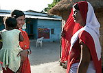 Priyanka Devi with her daghter Kriti Kumari speaks with Anganwadi health worker Nirmala Kumari at the Anganwadi clinic where oral rehydration salts (ORS) and zinc tablets are avaiable to combat her daughters potentially fatal diarrhea in her home village of Vaishali.The village located in Vaishali district outside Patna in Bihar, India has been rolling out the ORS and Zinc program as part of the IKEA Social Initiative to combat child mortality rates caused by diarrhea. It is proving to be very successful with education and support provided by local nursing staff, health activists  and program officers from UNICEF. The treatment is a 14 day course administering diluted oral rehydration salts and a zinc tablet which is more effective than salts alone in combating the effects of severe diarrhea. Picture by Graham Crouch/UNICEF