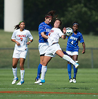 Gilda Doria (21) of Duke goes up for a header with Danielle Colaprico (24) of Virginia during the game at Klockner Stadium in Charlottesville, VA.  Virginia defeated Duke, 1-0.