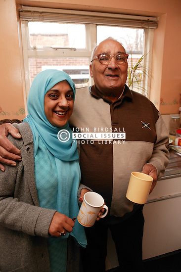 Asian carer with elderly Asian man in the kitchen making tea, ***NOT TO BE USED IN THE EAST MIDLANDS***