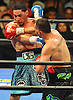 Danny Garcia, left, takes a jab from Brooklyn native Paulie Malignaggi in the main event during a 12-round Premier Boxing Champions match at the Barclays Center on Saturday, August 1, 2015. Garcia won the bout by TKO in the ninth round. <br /> <br /> James Escher
