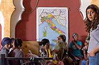 Roma 27 Giugno 2015<br /> Francesca Immacolata Chaouqui (R),ex componente della Commissione Cosea sulle strutture finanziarie del Vaticano, con i volontari al  centro di accoglienza  per migrati Baobab, vicino alla stazione Tiburtina.<br /> Al centro di accoglienza  per migrati Baobab, vicino alla stazione Tiburtina continua afflusso di migranti  provenienti soprattutto dall' Eritrea, ogni giorno circa 700 migranti mangiano al centro  e 300 sono ospitati la notte. Medici volontari controllano lo stato di salute dei rifugiati al centro Baobab.<br /> Rome June 27, 2015<br /> Francesca Immacolata Chaouqui (R), former member of Cosea Commission on the financial structures of the Vatican, imputed to the process Vatileaks,with the volunteers at the reception centre for immigrants, Baobab, in Tiburtina neighbourhood.<br /> At the Humanitarian emergency reception centre for immigrants, Baobab, in Tiburtina neighbourhood. continuous influx of migrants coming mainly from 'Eritrea, every day about 700 migrants eat in the centre and 300 are housed at night. Volunteer doctors monitor the health of refugees at the center Baobab.