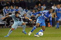 Patrice Bernier (8) Montreal midfielder goes past Paulo Nagamura Sporting KC..Sporting Kansas City defeated Montreal Impact 2-0 at Sporting Park, Kansas City, Kansas.