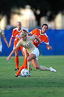 21 August 2011:  FIU's Nicole DiPerna (16) battles Florida's Holly King (10) for the ball in the first half as the University of Florida Gators defeated the FIU Golden Panthers, 2-0, at University Park Stadium in Miami, Florida.