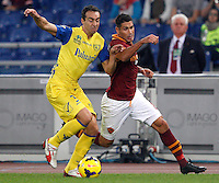 Calcio, Serie A: Roma vs ChievoVerona. Roma, stadio Olimpico, 31 ottobre 2013.<br /> ChievoVerona defender Dario Dainelli and AS Roma forward Marco Borriello, right, fight for the ball during the Italian Serie A football match between AS Roma and ChievoVerona at Rome's Olympic stadium, 31 October 2013.<br /> UPDATE IMAGES PRESS/Riccardo De Luca