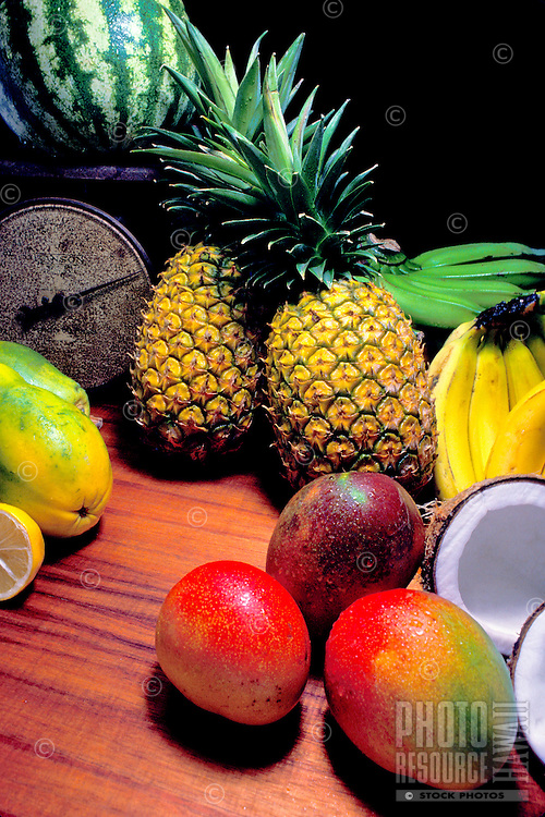 Island fruits: pineapple, banana, coconut, watermelon, orange, papaya and mango