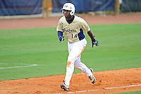 4 March 2012:  FIU outfielder Jabari Henry (14) runs home as the FIU Golden Panthers defeated the Brown University Bears, 8-3, at University Park Stadium in Miami, Florida.
