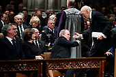 Former President George W. Bush shakes hands with former Sen. Alan Simpson, R-Wyo, after he spoke during the State Funeral for former President George H.W. Bush at the National Cathedral, Wednesday, Dec. 5, 2018, in Washington. Watching are Jeb Bush and Laura Bush.<br /> Credit: Alex Brandon / Pool via CNP