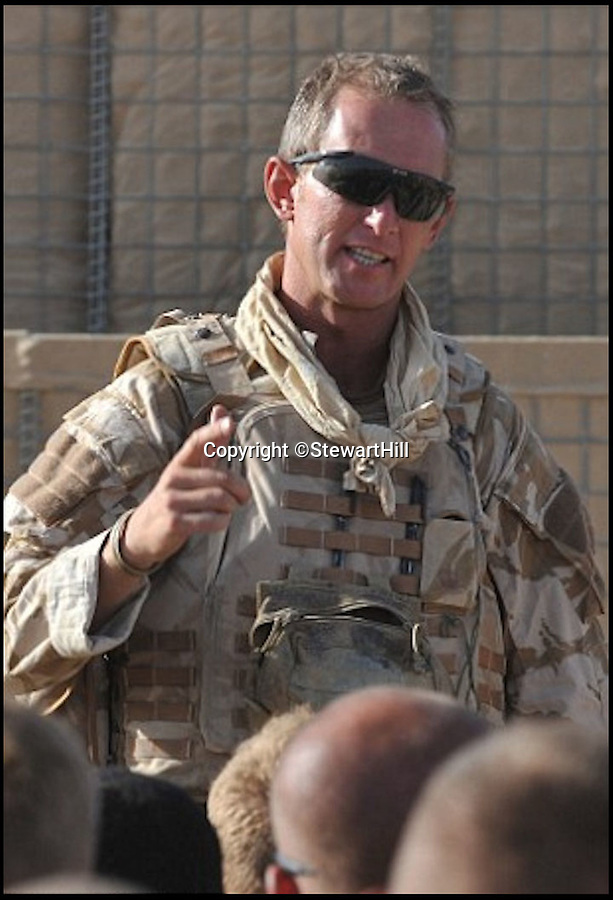 BNPS.co.uk (01202 558833)Pic: StewartHill/BNPS<br /> <br /> Stewart Hill in Afghanistan.<br /> <br /> An army hero who suffered life-changing injuries in Afghanistan is now forging a new career as a portrait painter after art became part of his recovery.<br /> <br /> To the unknowing eye Lt Col Stewart Hill looks a picture of health, but he has a severe traumatic brain injury after an IED exploded next to him nine years ago.<br /> <br /> Lt Col Hill was medically discharged from the army but his injuries make it impossible for him to maintain a 'normal' job.<br /> <br /> Struggling to come to terms with what had happened he turned to painting, something he had not done since school, as part of his therapy.<br /> <br /> But it has now turned into a career, with him winning prestigious prizes and lining up a host of well-known faces to sit for him including actor Ray Winstone, TV presenter Nick Knowles and choirmaster Gareth Malone.