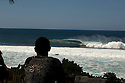 Surfer watching the Pipeline on the North Shore in Hawaii