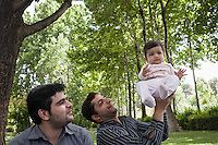 Iranian doing picnic at the park of Isfahan. Iranian have a love affair with picnic. Anytime during weekend or holiday, people often go to park or any open public space to gather and sharing meals with the families and friend.