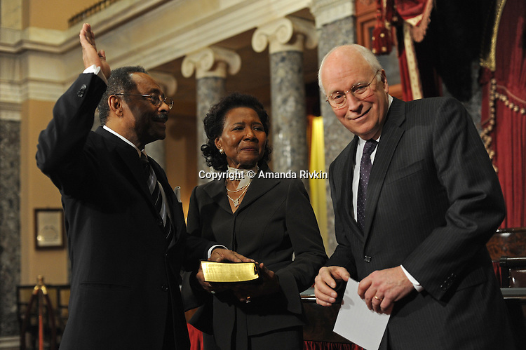 Senator Roland Burris stands beside his wife Berlean Burris as he is sworn in to the U.S. Senate by Vice President Dick Cheney in the old Senate chamber of the U.S. Senate in Washington, DC on January 15, 2008.