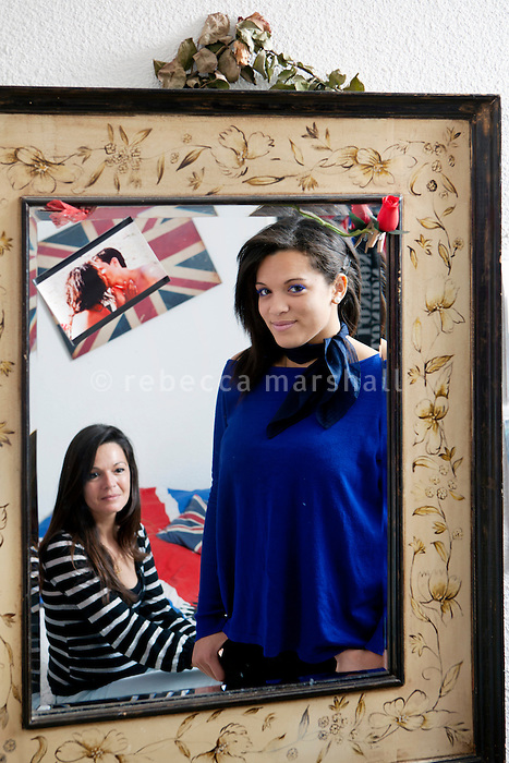 Sophie Serrano (seated) and her daughter Manon, 19 years old, pose for the photographer in Manon's bedroom, Thorenc, France, 11 November 2013. When Manon was 10 years old, DNA tests showed that Sophie was not her biological mother - just as her father, who had left Sophie when Manon was 3 years old, suspecting that he was not Manon's true father, was indeed not her biological father. It was discovered that Sophie's baby had been exchanged with another in the maternity clinic, 5 days after birth. Both children live today with the families that raised them.