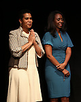 """Leslie Malaika Lewis and Immaculee Ilibagiza on stage during """"Miracle in Rwanda"""" honoring International Day of Reflection on the 1994 Genocide against the Tutsi in Rwanda at the Lion Theatre on Theater Row on April 7, 2019 in New York City."""