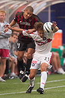 Craig Ziadie of the MetroStars and Justin Mapp of the Fire go for a header.The Chicago Fire defeated the NY/NJ MetroStars 3-2 on 6/14/03 at Giant's Stadium, NJ..