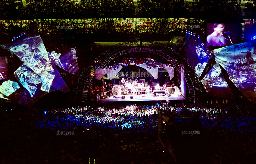 The Grateful Dead Live in Concert at Giants Stadium June 17, 1991. Audience, Band, Stage, Set Design, especially the Wings, and Lights Capture Image.