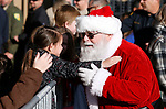 Santa greets students at the 16th annual Holiday With a Hero shopping day, in Carson City, Nev., on Wednesday, Dec. 18, 2019. The event pairs law enforcement, fire, military and medical officials with homeless children from the Carson City School District McKinney-Vento program for a $100 shopping spree at Walmart.<br /> Photo by Cathleen Allison