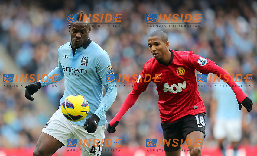 Manchester City's Mario Balotelli holds off United's Ashley Young - Football - Manchester City v Manchester United - Barclays Premier League - Etihad Satdium - Season 12/13 - 09/12/12 Credit - Paul Bradbury/Sportimage .Manchester 9/12/2012.Football Calcio 2012/2013 Premier League.Manchester City Vs Manchester United.Foto Sportimage / Insidefoto.ITALY ONLY