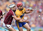 Daithi Burke of Galway in action against John Conlon of Clare during their All-Ireland semi-final at Croke Park. Photograph by John Kelly.