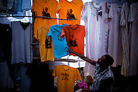 locally printed t shirts  of President Elect Barack Obama feautuing scripts in Hammaric language are displayed In Amhara's regional capital Bahir Dar's main market by a shop keeper that is arranging them after showing them to a customer on President Barack Obama's inauguration day, Tuesday January 20 2009..
