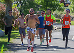 The Runny Bums team runs to the finish line at the 2019 Reno Tahoe Odyssey at Idlewild Park in Reno on Saturday, June 1, 2019.