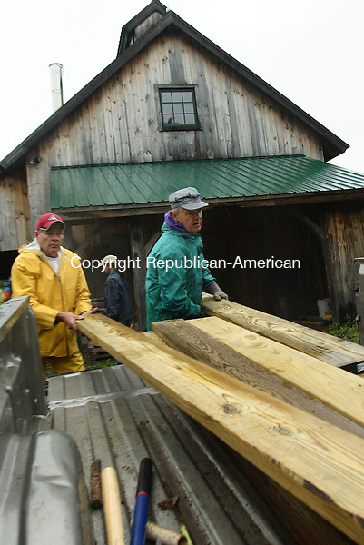 """Woodbury, CT- 03 June 2006-060306MK03 (left) Dave Terry  and Geoff Whan, both volunteers for the Land management Committee, load lumber which will be used to create a board walk over muddy low lying areas on the trails.  Saturday was """"Trails Day"""" and Terry Whan were among a handful of volunteers who came out to help repair and maintenance of trails at the Van Vleck Farm Sanctuary at the Flanders Nature Center in Woodbury Saturday morning.  Michael Kabelka / Republican-American (Dave Terry  and Geoff Whan)CQ"""