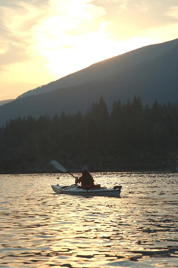 Anna Rose kayaking at sunset. Kootenay Lake, BC