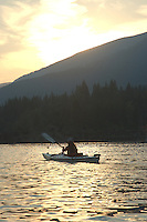 Anna Rose kayaking at sunset. Kootenay Lake, BC