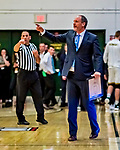 8 December 2018: University of Vermont Meghan and Robert Cioffi Men's Basketball Head Coach John Becker gives instruction during the first half of play against the Harvard University Crimson at Patrick Gymnasium in Burlington, Vermont. The America East Catamounts overcame a 10-point 2nd half deficit, to defeat the Ivy League Crimson 71-65 in NCAA Division I inter-league play. Mandatory Credit: Ed Wolfstein Photo *** RAW (NEF) Image File Available ***