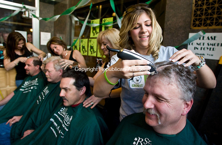 TORRINGTON, CT - 03 APRIL 2010 -040310JT01-<br /> From right, Torrington Fire Chief John Field gets his head shaved by his daughter Felicia as Platinum Salon owner Diane Concannon shaves Torrington Fire Deputy Chief Gary Brunoli's head, Platinum Salon employee Denee Longley shaves Torrington Deputy Fire Marshal Butch Hine's head, and Platinum Salon employee Francine Patrick shaves Torrington Police Officer Steve Pisarski's head during a fundraiser for the St. Baldrick's Foundation on Saturday at the Cambridge House Brew Pub in Torrington.<br /> Josalee Thrift Republican-American
