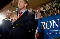 Senator Rand Paul introduces his father, congressman Ron Paul, at a town hall meeting and rally at the Church Landing at Mills Falls hotel in Meredith, New Hampshire, on Jan. 8, 2012. Paul is seeking the 2012 Republican presidential nomination.
