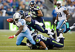 Tennessee Titans' running back Chris Johnson is tackled for a two-yard loss by Seattle Seahawks' strong safety Roy Lewis at CenturyLink Field in Seattle, Washington on August 11, 2012. ©2012. Jim Bryant Photo. All Rights Reserved..
