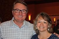 NWA Democrat-Gazette/CARIN SCHOPPMEYER Joey Walters, Arkansas Activities Assocition deputy director, and Rhonda Fincher visit at the Beat the Heat luncheon July 27.