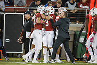 Stanford, CA - October 05, 2019: Celebration along the sidelines during the Stanford vs Washington football game Saturday night at Stanford Stadium.<br /> <br /> Stanford won 23-13.