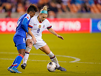 HOUSTON, TX - JANUARY 28: Julie Ertz #8 of the United States defends her space against Melchie Dumonay #6 of Haiti during a game between Haiti and USWNT at BBVA Stadium on January 28, 2020 in Houston, Texas.