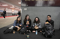 From left, Maggie Saucedo '22, Erin Kim '23, Bia Pinho '23 and Joaquin Madrid Larranaga '23 wait for their flight at Burbank Airport.<br /> Eleven Occidental College first-years and sophomores traveled with Career Services staff and Senior Associate Dean of Students Erica O'Neal Howard to San Francisco for a day to visit Cambridge Associates, managers of Oxy's endowment, as part of their workforce diversity initiative. They were invited to meet with employees (including two alums), tour the office, and learn about careers in investment management. Students were able to see how their quantitative courses could be applied to future career opportunities.<br /> January 17, 2020.<br /> (Photo by Marc Campos, Occidental College Photographer)