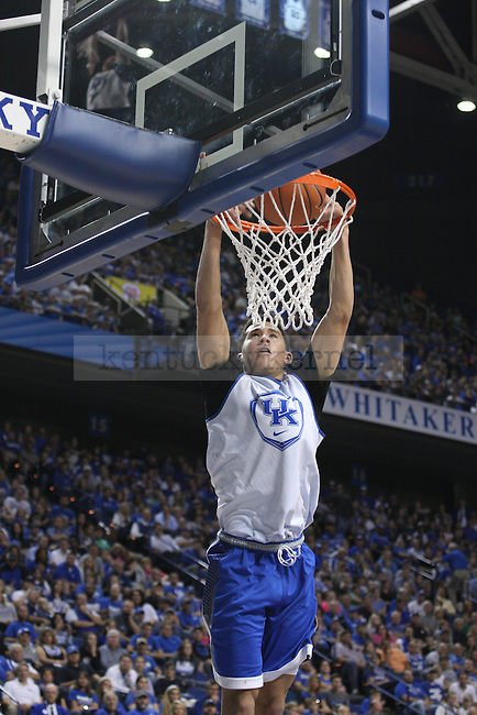 Guard Devin Booker soars to dunk the ball during the first half of the Blue-White Scrimmage at Rupp Arena on Monday, October 27, 2014 in Lexington, Ky. Photo by Adam Pennavaria | Staff