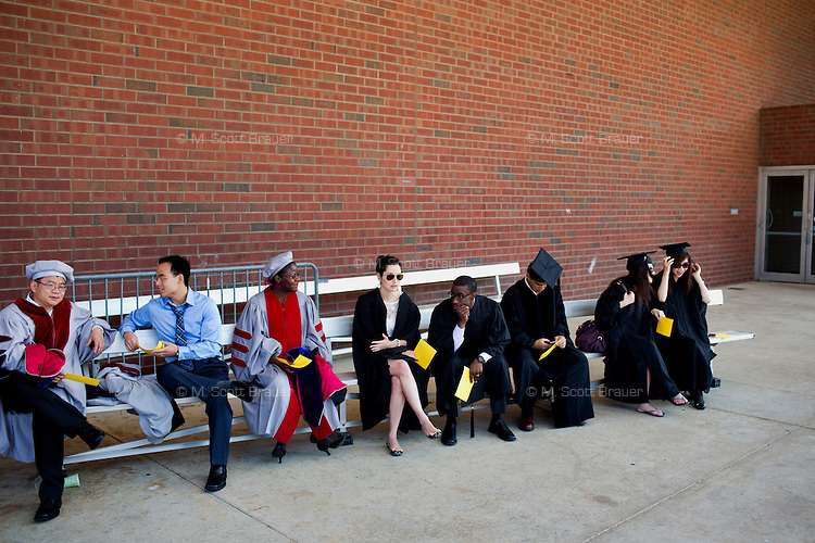 Graduating students late to the lineup wait outside the Johnson Athletics Center before the 2012 MIT Commencement on June 8, 2012, in Cambridge, Massachusetts, USA...Photo by M. Scott Brauer
