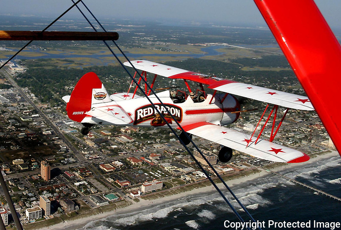 11/03/05....Gary Wilcox/The Times Union... The Red Baron Pizza Squadron fly by  Jacksonville Beach where Beach Blvd ends. This past November during the Jacksonville Sea & Sky Spectacular at Jacksonville Beach.