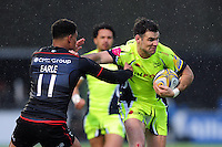 Mike Phillips of Sale Sharks fends Nathan Earle of Saracens. Aviva Premiership match, between Saracens and Sale Sharks on February 25, 2017 at Allianz Park in London, England. Photo by: Patrick Khachfe / JMP