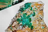 A rough emerald gemstone, together with the polished stones, are seen in the jewelry workshop in Bogota, Colombia, 8 February 2014. Around 60% of the world's emerald production come from Colombia. Most of the gemstones are cut, faceted and processed into jewelry in the workshops located in the emerald district in downtown Bogota. There are approximately 2000 jewelers working in the emerald district. Due to their special clarity and deep vivid green color, Colombian emeralds are considered the most beautiful in the world.