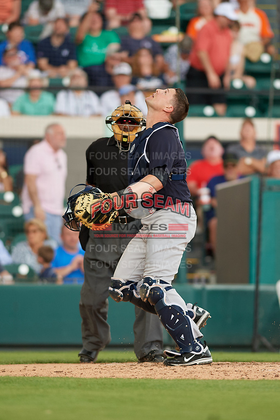 New York Yankees catcher Ryan Lavarnway (30) tracks a pop up foul ball as umpire Laz Diaz looks on during a Grapefruit League Spring Training game against the Detroit Tigers on February 27, 2019 at Publix Field at Joker Marchant Stadium in Lakeland, Florida.  Yankees defeated the Tigers 10-4 as the game was called after the sixth inning due to rain.  (Mike Janes/Four Seam Images)