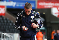 Jamie Vardy of Leicester City looks at his phone as he arrives before the Barclays Premier League match between Swansea City and Leicester City played at The Liberty Stadium on 5th December 2015