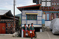 Yong Bhutanese girls wearing the national dress Kira coming back from school at Bumthang. Arindam Mukherjee..