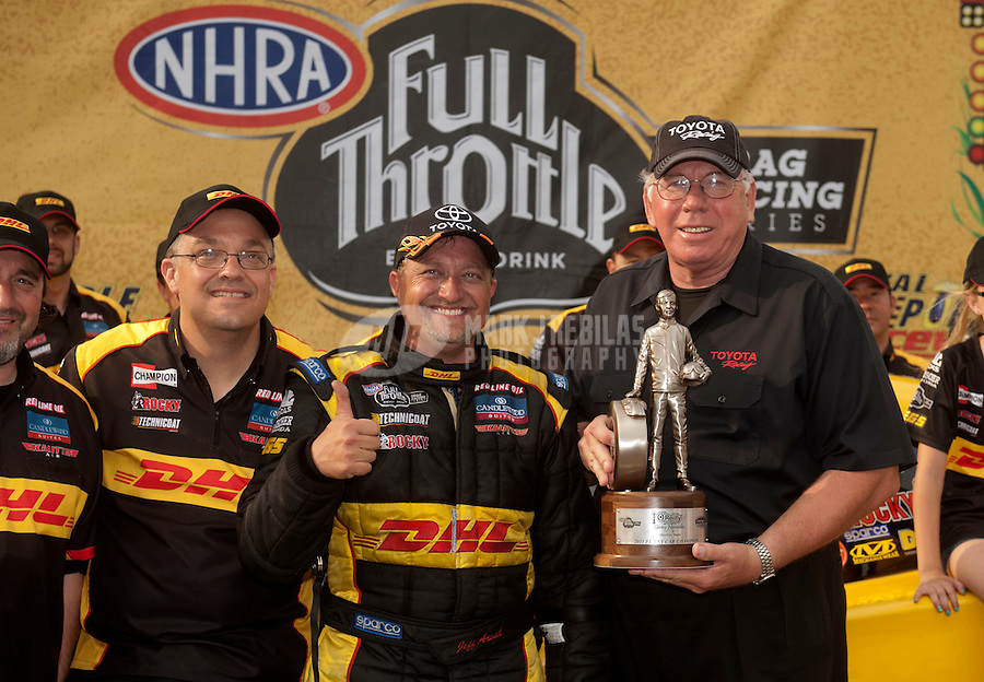 May 1, 2011; Baytown, TX, USA: NHRA funny car driver Jeff Arend celebrates after winning the Spring Nationals at Royal Purple Raceway. Mandatory Credit: Mark J. Rebilas-