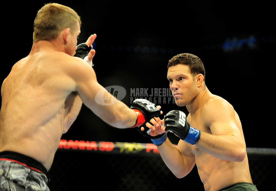 Aug. 7, 2010; Oakland, CA, USA; UFC fighter Ricardo Almeida (right) against Matt Hughes (left) during the welterweight bout in UFC 117 at the Oracle Arena. Mandatory Credit: Mark J. Rebilas